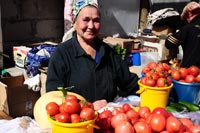Russian babushka selling tomatoes in Novosibirsk central market