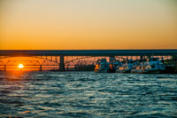 Sunset on the Ob River and view on Novosibirsk bridge